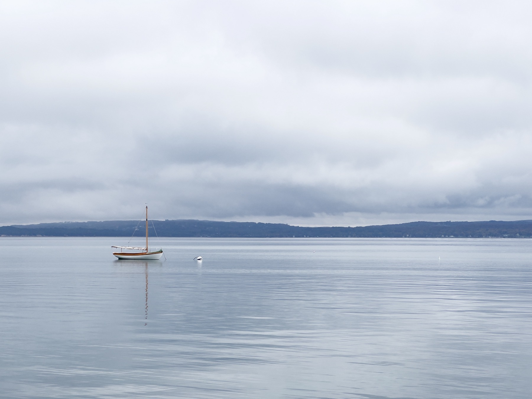 Small sailboat on calm water.